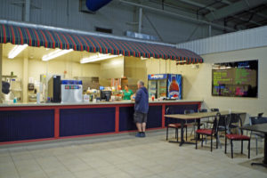 concessions counter with table and chairs at Crown Center, Eden MD